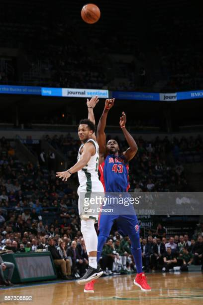 Anthony Tolliver of the Detroit Pistons shoots the ball against Rashad Vaughn of the Milwaukee Bucks on December 6 2017 at the BMO Harris Bradley...