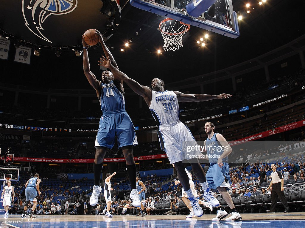 Anthony Tolliver #44 of the Minnesota Timberwolves pulls down a rebound against Brandon Bass #30 of the Orlando Magic on November 3, 2010 at the Amway Center in Orlando, Florida.