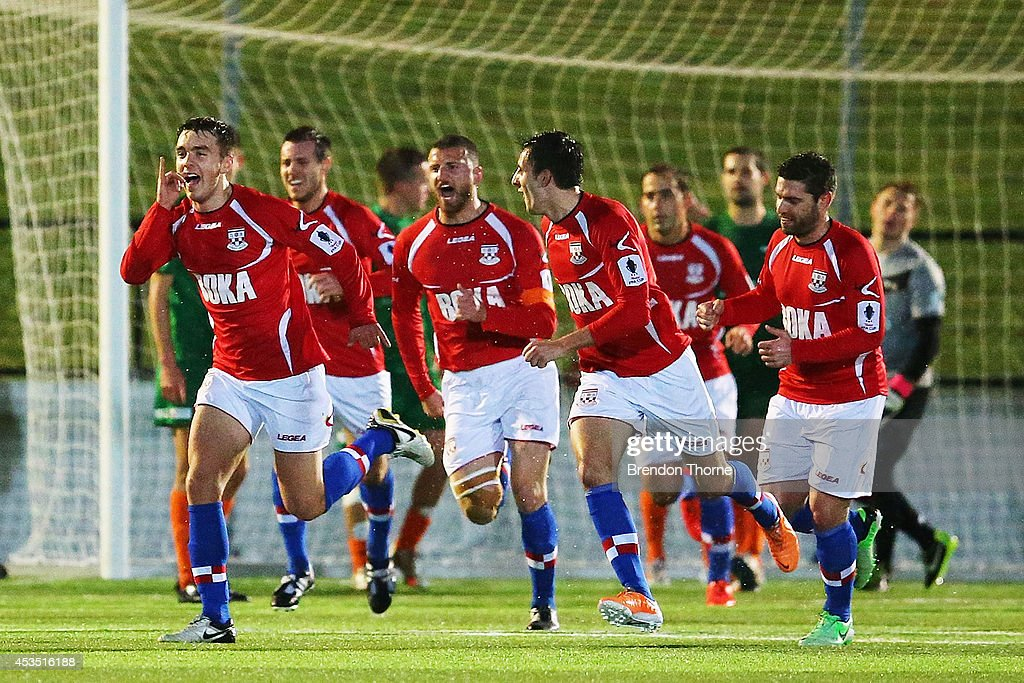 Anthony Tomelic of United celebrates after scoring the opening goal during the FFA Cup match between Sydney United 58 FC and the FNQ Heat at Sydney United Sports Centre on August 12, 2014 in Sydney, Australia.