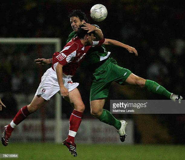 Anthony Tonkin of Forest Green Rovers and Mark Hudson of Rotherham challenge for the ball during the FA Cup sponsored by EON First Round Replay match...