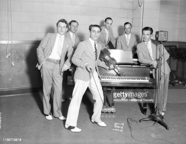 Anthony 'Tony' Salerno's Gypsy Melodians posing at WIBA studios Madison Wisconsin August 23 1932 Tony is leaning against the piano with his violin...