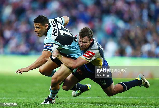 Anthony Tupou of the Sharks is tackled by Gavin Cooper of the Cowboys during the NRL Elimination Final match between the Cronulla Sharks and the...