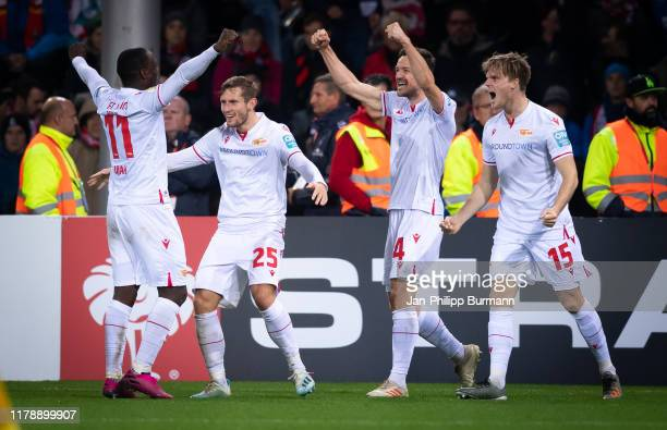 Anthony Ujah Christopher Lenz Christian Gentner and Marius Buelter of 1 FC Union Berlin celebrate after scoring the 13 during the DFB Cup match...