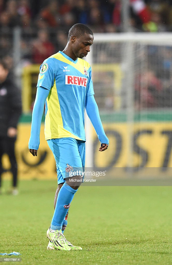 Anthony Ujah of 1. FC Koeln looks dejected as he leaves the pitch after the DFB Cup between SC Freiburg and 1. FC Koeln at Schwarzwald-Stadium on March 3, 2015 in Freiburg, Germany.