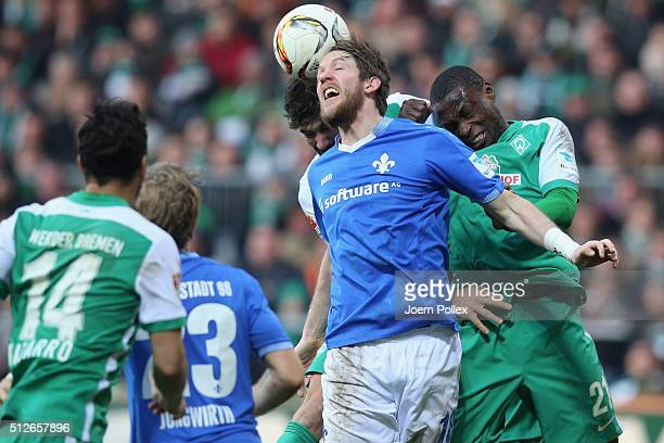 Anthony Ujah of Bremen and Peter Niemeyer of Darmstadt compete for the ball during the Bundesliga match between Werder Bremen and SV Darmstadt 98 at...