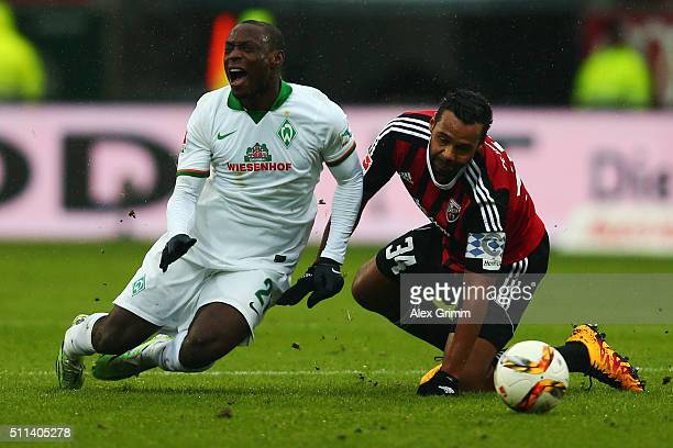 Anthony Ujah of Bremen is challenged by Marvin Matip of Ingolstadtduring the Bundesliga match between FC Ingolstadt and Werder Bremen at Audi...