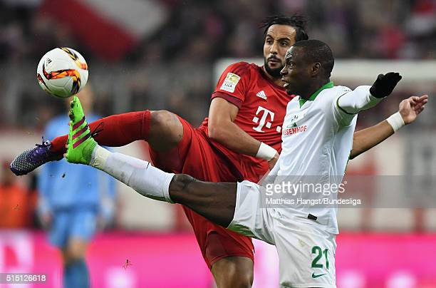 Anthony Ujah of Bremen is challenged by Medhi Benatia of Muenchen during the Bundesliga match between FC Bayern Muenchen and Werder Bremen at Allianz...