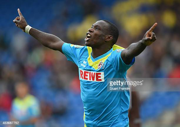 Anthony Ujah of Cologne celebrates scoring his second goal during the DFB Pokal match between FT Braunschweig and 1 FC Koeln on August 16 2014 in...