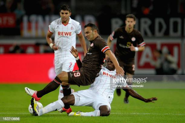 Anthony Ujah of Cologne challenges Mahir Saglik of St Pauli during the Second Bundesliga match between 1 FC Koeln and FC St Pauli at...