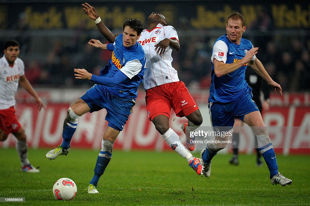 Anthony Ujah of Cologne reacts after being hit by Jonas Acquistapace of Bochum during the Second Bundesliga match between 1. FC Koeln and VfL Bochum at RheinEnergieStadion on November 23, 2012 in Cologne, Germany.