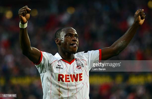 Anthony Ujah of Koeln celebrates after team mate Adil Chihi scored his teams second goal during the Second Bundesliga match betweeen 1 FC Koeln and...