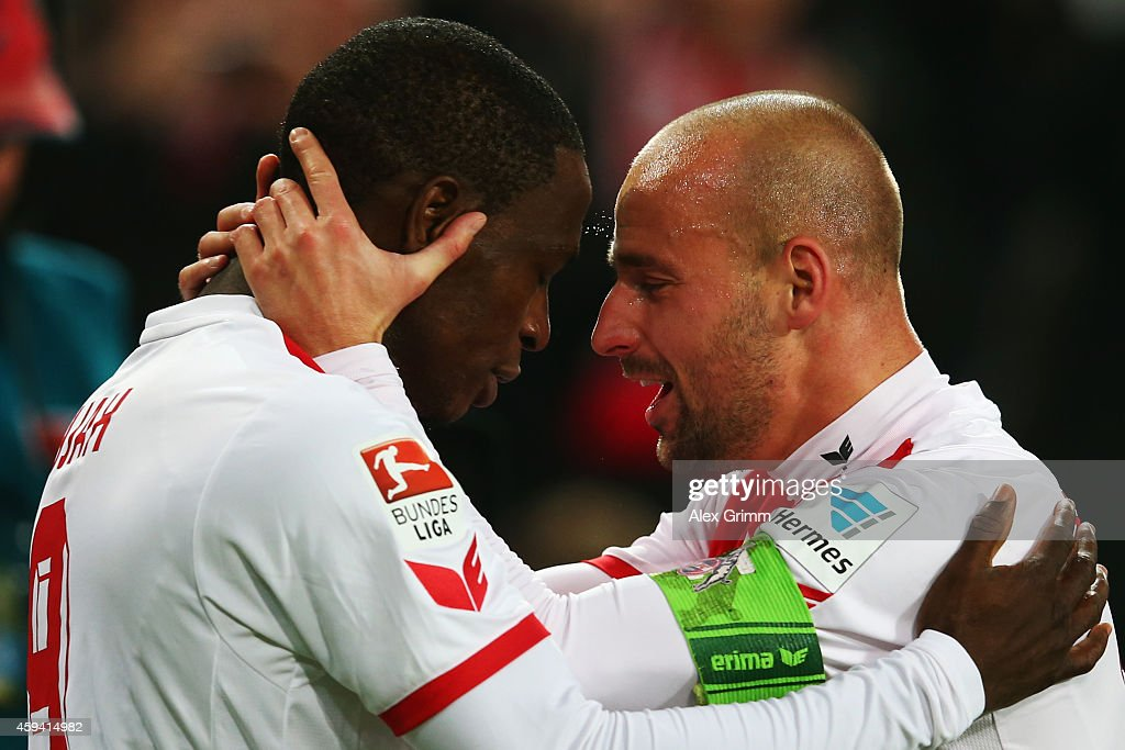 Anthony Ujah (L) of Koeln celebrates his team's first goal with team mate Miso Brecko during the Bundesliga match between 1. FC Koeln and Hertha BSC at RheinEnergieStadion on November 22, 2014 in Cologne, Germany.