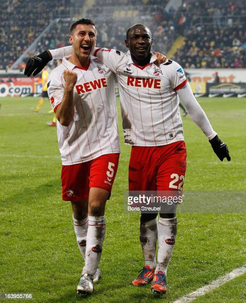 Anthony Ujah of Koeln celebrates his team's second goal with his team mate Dominic Maroh during the Second Bundesliga match between SG Dynamo Dresden...