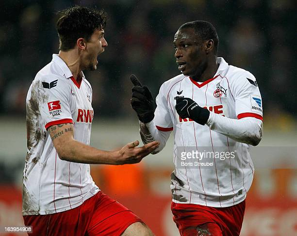 Anthony Ujah of Koeln celebrates with teammate Tobias Strobl after scoring the opening goal of the Second Bundesliga match between SG Dynamo Dresden...
