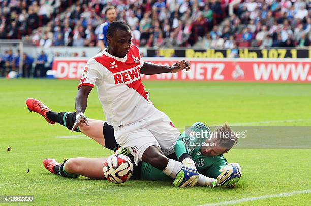 Anthony Ujah of Koeln is challenged by goalkeeper Ralf Faehrmann of Schalke during the Bundesliga match between 1 FC Koeln and FC Schalke 04 at...