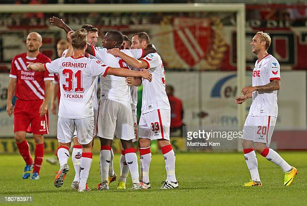 Anthony Ujah of Koeln jubilates with team mates after scoring the third goal during the Second Bundesliga match between FC Energie Cottbus and 1FC...