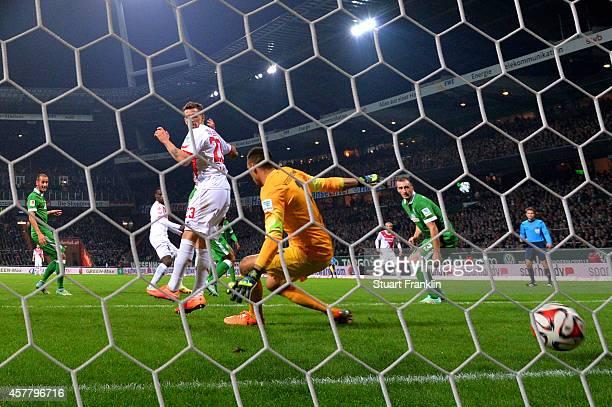 Anthony Ujah of Koeln scores the matchwinning goal past goalkeeper Raphael Wolf of Werder Bremen during the Bundesliga match between SV Werder Bremen...