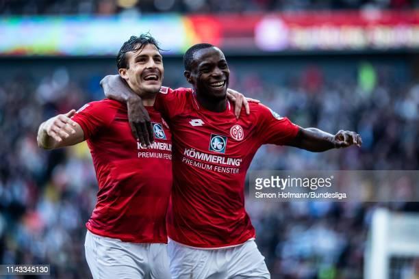 Anthony Ujah of Mainz celebrates a goal with team mate Giulio Donati during the Bundesliga match between Eintracht Frankfurt and 1 FSV Mainz 05 at...