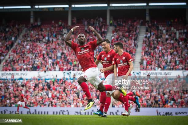 Anthony Ujah of Mainz celebrates his team's first goal with team mates during the Bundesliga match between 1 FSV Mainz 05 and FC Augsburg at Opel...