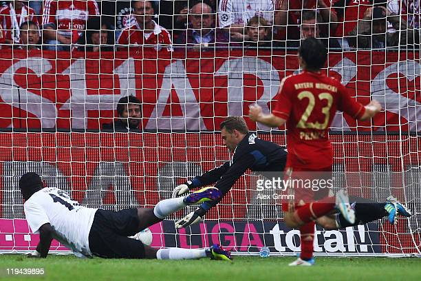 Anthony Ujah of Mainz scores his team's second goal against goalkeeper Manuel Neuer of Muenchen during the LIGA total! Cup 3rd place match between...