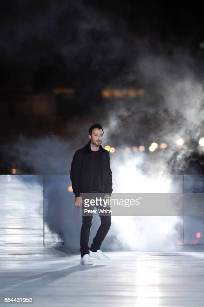 Anthony Vaccarello acknowledges the audience after the Saint Laurent show as part of the Paris Fashion Week Womenswear Spring/Summer 2018 on...