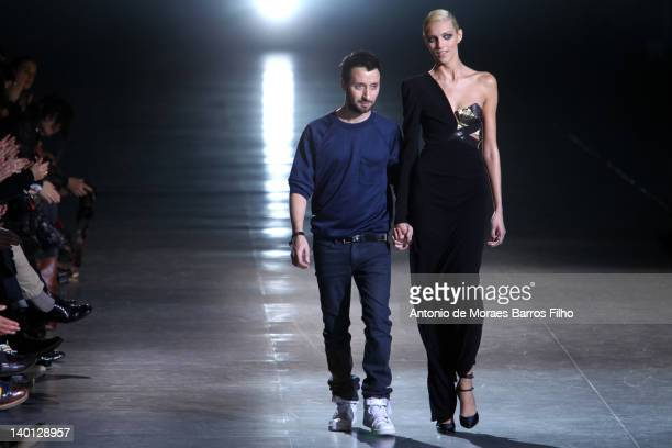 Anthony Vaccarello and Anja Rubik walk the runway during the Anthony Vaccarello ReadyToWear Fall/Winter 2012 show as part of Paris Fashion Week at...