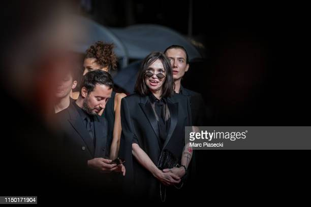 """Anthony Vaccarello and Beatrice Dalle attend the screening of """"Lux Aetterna"""" during the 72nd annual Cannes Film Festival on May 18, 2019 in Cannes,..."""