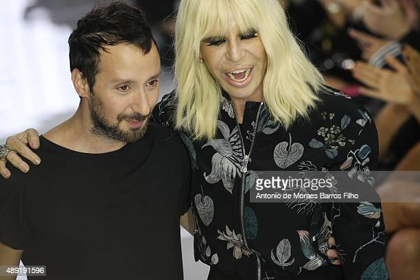 Anthony Vaccarello and Donatella Versace walk the runway of the Versus show during London Fashion Week Spring/Summer 2016/17 on September 19 2015 in...
