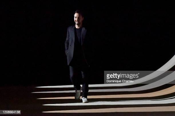 Anthony Vaccarello walks the runway after the Saint Laurent show as part of the Paris Fashion Week Womenswear Fall/Winter 2020/2021 on February 25,...