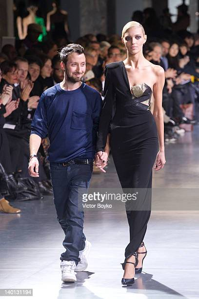 Anthony Vaccarello walks the runway during the Anthony Vaccarello ReadyToWear Fall/Winter 2012 show as part of Paris Fashion Week at Docks en Seine...