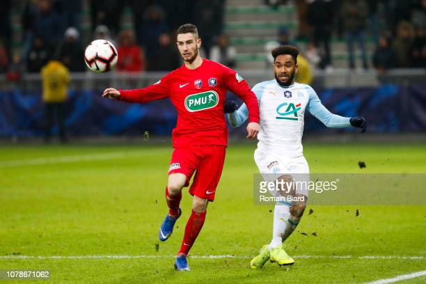 Anthony Vacheron of Andrezieux and Jordan Amavi of Marseille during the French Cup match between Andrezieux and Marseille at Stade GeoffroyGuichard...