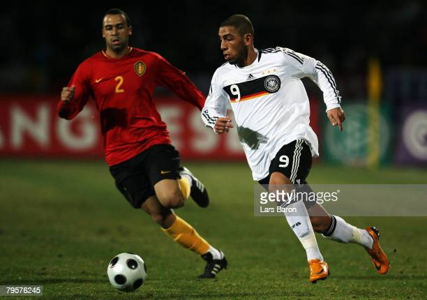 Anthony vanden Borre of Belgium in action with Ashkan Dejagah of Germany during the friendly match between U21 of Germany and U23 of Belgium at the...