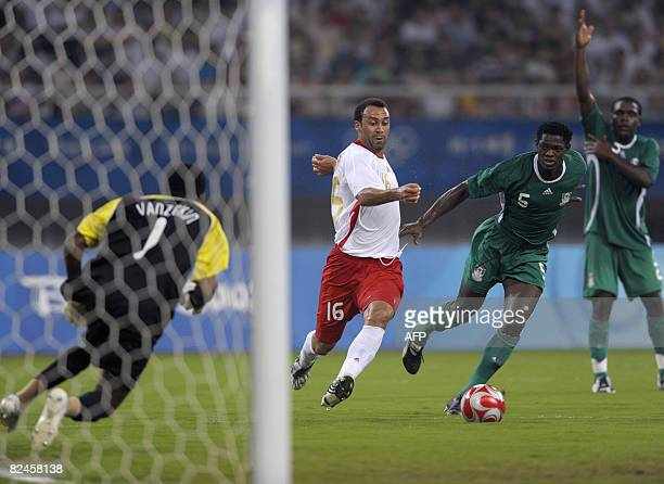 Anthony Vanden Borre of Belgium tries to score as goalkeeper Ambruse Vanzekin and Dele Adeleye of Nigeria defend during the 2008 Beijing Olympic...