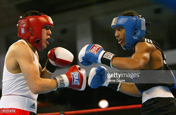 Anthony Vasquez faces off with Karl Dargan during the United States Olympic Team Boxing Trials at Battle Arena on February 19 2004 in Tunica...