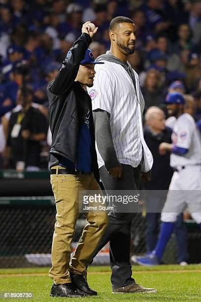 Anthony Velazquez delivers the game ball with former Chicago Cubs player Derrek Lee before Game Three of the 2016 World Series between the Chicago...