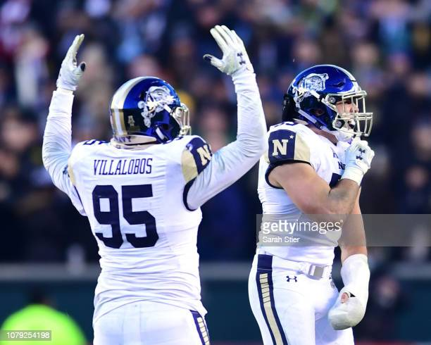 Anthony Villalobos and Carter Bankston of the Navy Midshipmen react after the Army Black Knights missed a field goal opportunity during the second...