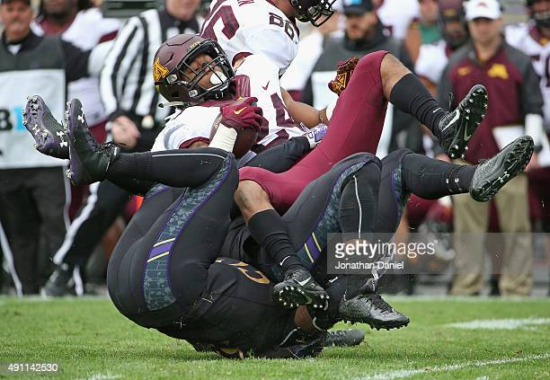 Anthony Walker and Drew Smith of the Northwestern Wildcats tackle Rodney Smith of the Minnesota Golden Gophers at Ryan Field on October 3, 2015 in...