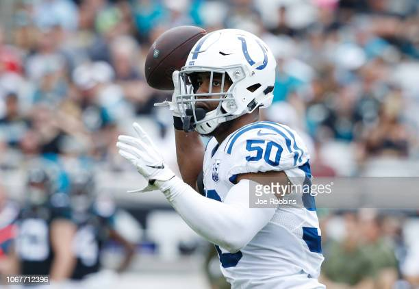 Anthony Walker of the Indianapolis Colts celebrates after his interception in the first half of a game against the Jacksonville Jaguars at TIAA Bank...