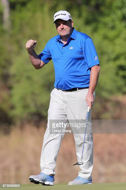 Anthony Wall of England celebrates after a putt shot during the first round of the 2017 Volvo China open at Topwin Golf and Country Club on April 27...