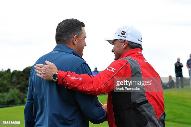 Anthony Wall of England is congratulated by tournament host Paul Lawrie of Scotland after his win in the final match on day four of the Aberdeen...