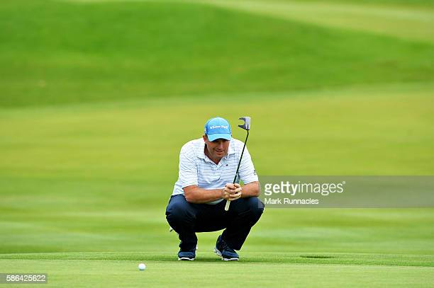 Anthony Wall of England lines up a putt on the green on hole 18 on day three of the Aberdeen Asset Management Paul Lawrie Matchplay at Archerfield...