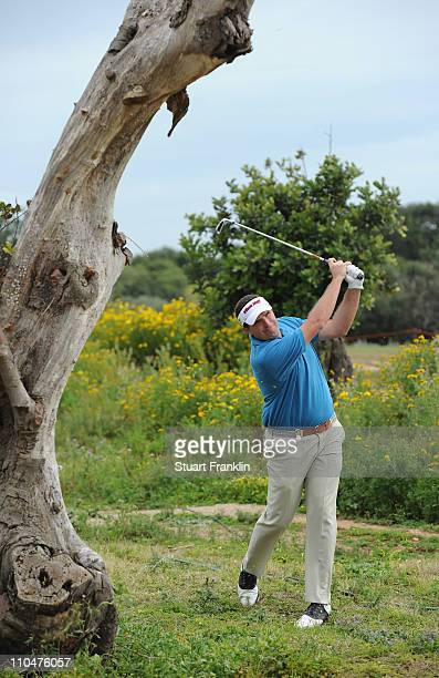 Anthony Wall of England plays his approach shot on the 14th hole during the third round of the Sicilian Open at the Donnafugata golf resort and spa...