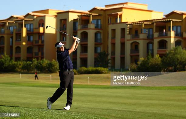 Anthony Wall of England plays into the 9th green during the first round of the Portugal Masters at the Oceanico Victoria Golf Course on October 14...