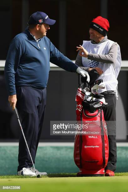 Anthony Wall of England speaks to his caddie before he hits a tee shot during the European Tour KLM Open ProAM held at The Dutch on September 13 2017...