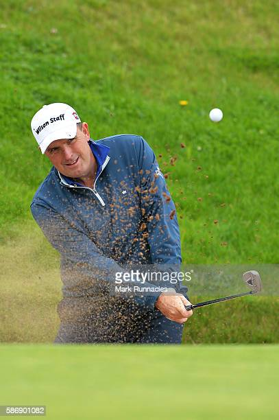 Anthony Wall of England takes a bunker shot on hole 16 on day four of the Aberdeen Asset Management Paul Lawrie Matchplay at Archerfield Links Golf...