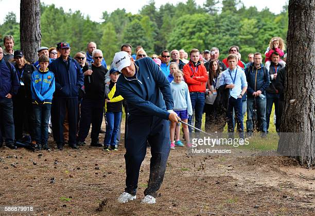 Anthony Wall of England takes his second shot from the trees on hole 1 on day four of the Aberdeen Asset Management Paul Lawrie Matchplay at...