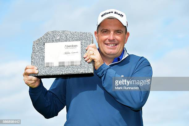 Anthony Wall of England with his trophy for winning the tournament on day four of the Aberdeen Asset Management Paul Lawrie Matchplay at Archerfield...