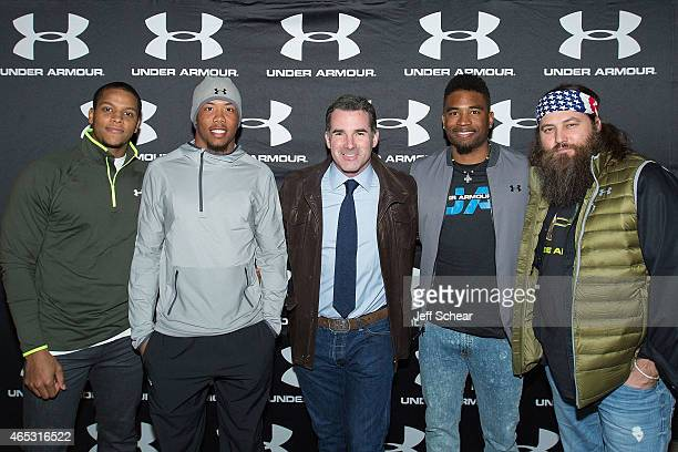 Anthony Walters Kyle Fuller Kevin Plank Manteo Mitchell and Willie Robertson attend Under Armour opens largest brand house on Chicago's Magnificent...