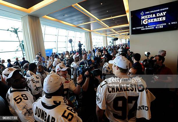Anthony Waters JoLonn Dunbar and Jeff Charleston of the New Orleans Saints speak to members of the media during Super Bowl XLIV Media Day at Sun Life...