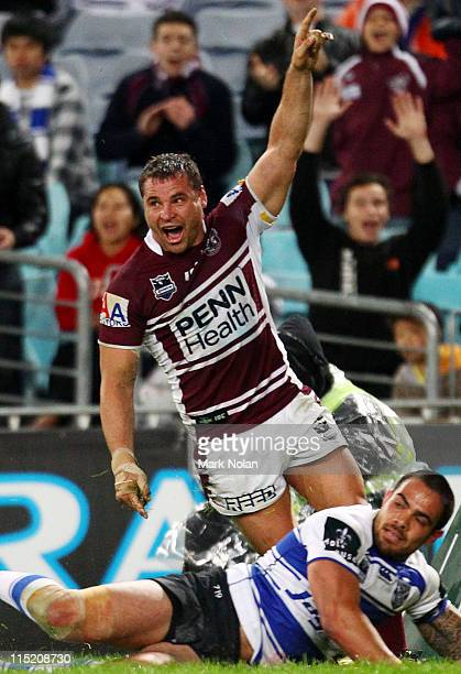 Anthony Watmough of the Eagles celebrates his try during the round 13 NRL match between the Caterbury Bulldogs and the Manly Warringah Sea Eagles at...